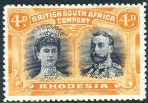 RHODESIA-1910-13 4d Greenish Black & Orange Perf 14 mounted mint example Sg 138