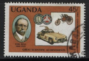 UGANDA 567, USED, 1987 Karl Benz German engineer and Mercedes Benz coupe