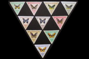 MINT STAMP LOT WITH TRIANGLE SHAPED STAMPS REPUBLIC OF SOUTH MALUKU. ITEM 8