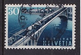 Switzerland   #311  used  1947   Swiss railroad 30c  electric trains on bridge