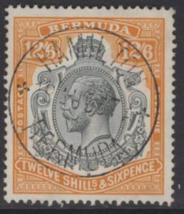 BERMUDA SG93 1932 12/6 GREY & ORANGE BREAK IN SCROLL TO RIGHT OF CROWN F.USED