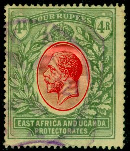 EAST AFRICA and UGANDA SG56,4r red&grn/yw,USED.Cat £110.MULT CA. FISCAL POSTMARK