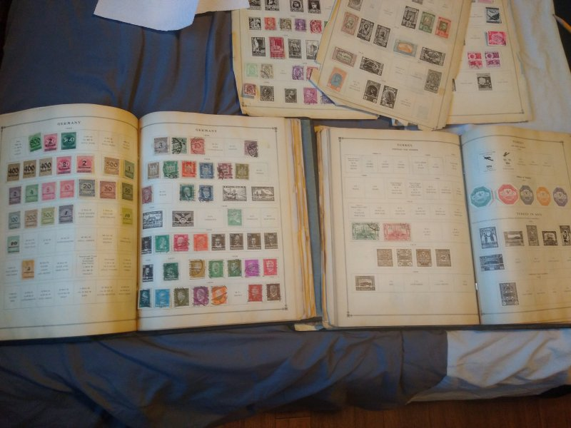 Two international junior postage stamp albums with 1000+ stamps inside