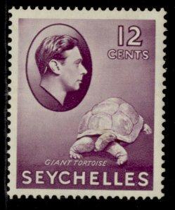 SEYCHELLES GVI SG139, 12c reddish violet, LH MINT. Cat £50.