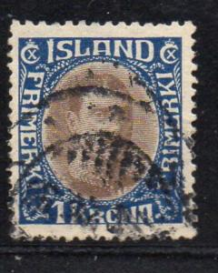 Iceland Sc 185 1931 1 kr dark blue & light brown Christian X stamp used