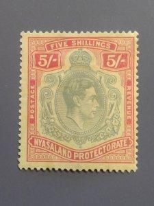 Nyasaland Protectorate 65 F-VF MHR. Scott $ 35.00