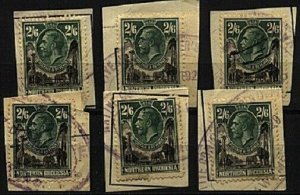 NORTHERN RHODESIA 1925 GV 2/6d SG12 x 6 fiscally used on pieces...........98527