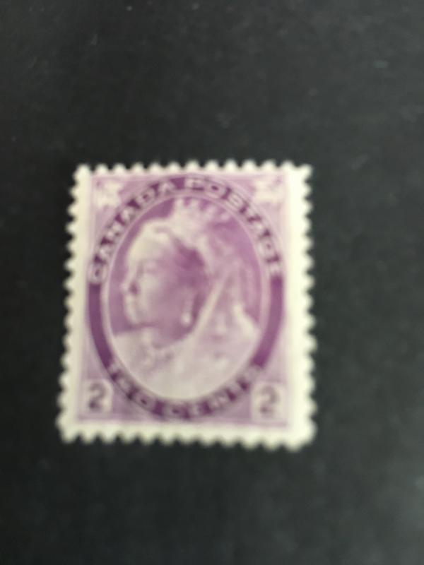 Canada #76 Mint 2c Purple Numeral O.G. Slight Bend og Gum O/W F-NH Cat. $30.