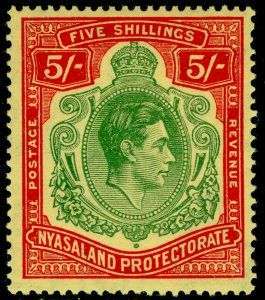 NYASALAND PROTECTORATE SG141a,5s grn&red/pale yw,VLH MINT.Cat £80.ORDINARY PAPER