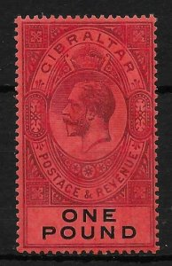 GIBRALTAR SG85 1912 £1 DULL PURPLE & BLACK ON RED MTD MINT
