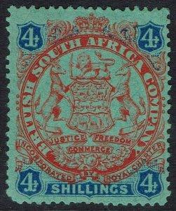 RHODESIA 1896 ARMS 4/-