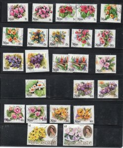 Niue small accumulation of used stamps mainly flower topicals