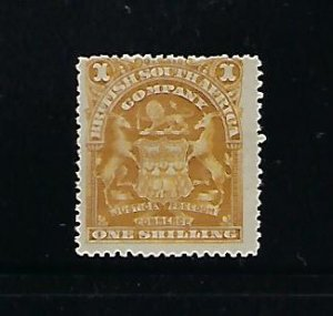 RHODESIA SCOTT #66 1898-1908 COAT OF ARMS- 1SH (BISTER)  -MINT  HINGED