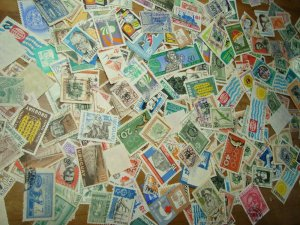 Uruguay used clean stamp stock lot accumulation 80 grams many topicals