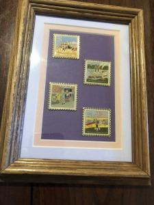 4 Classic Mail Transporataion Stamp Pins Under Glass in a Wood Frame