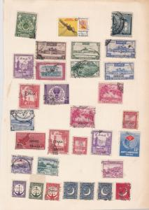pakistan stamps on album page ref r9415