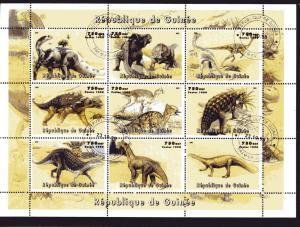 25 x Guinea 98  Dinosaurs Shlt (9) CTO  perf.