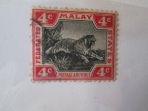 Malaya #28 used  2019 SCV = $1.00