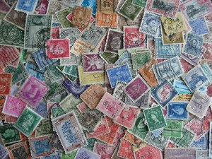 Worldwide perfins, 200 from various countries. Duplicates?, mixed condition.