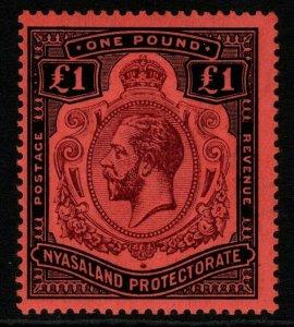 NYASALAND SG98a 1913 £1 PURPLE & BLACK/RED BREAK IN SCROLL MTD MINT