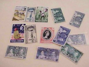 TURKS & CAICOS STAMPS 13 MOSTLY DIFFERENT MOSTLY MINT  LIGHT HINGED