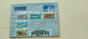 GB  UNADDRESSED SINGAPORE REGISTERED AEROGRAM TIED WITH ST HELENA FISH SET