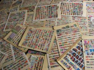 WW boxlot stamps haphazardly stuck into stock pages,no apparent order,what lurks
