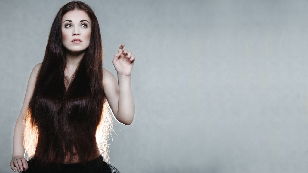 Why won't my hair grow any longer? Slow growth causes & what to do