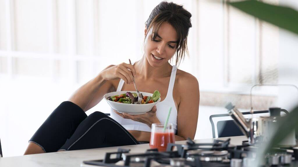 Woman having a bowl of salad for lunch