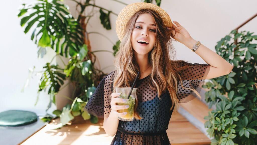 Woman drinking a delicious healthy beverage