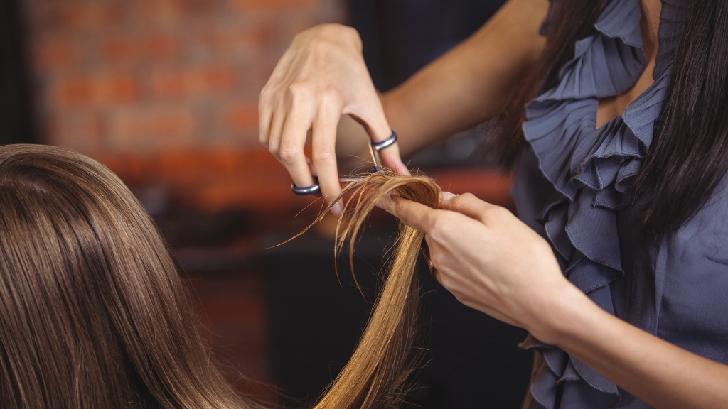 Hairdresser clipping a woman's hair
