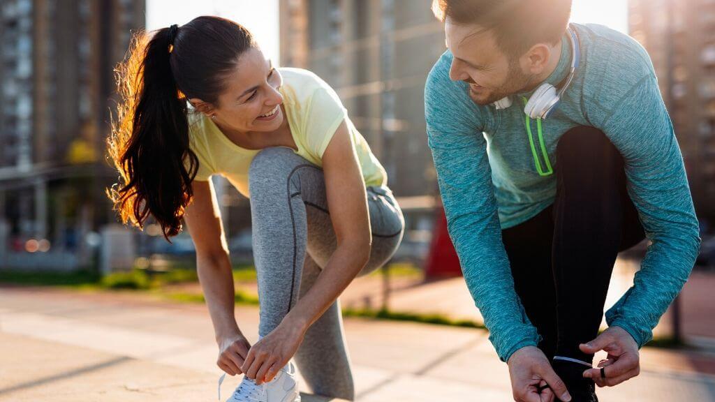 A couple preparing for a jog