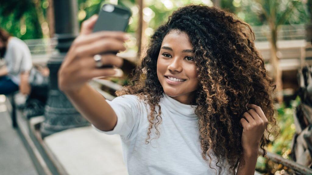 A woman taking a selfie outdoors