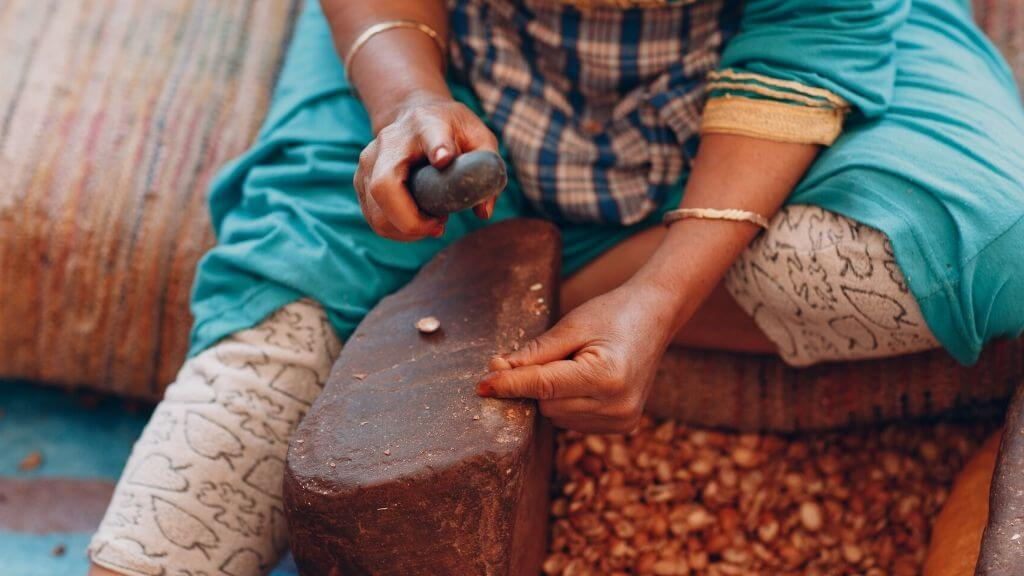 A woman preparing argan oil