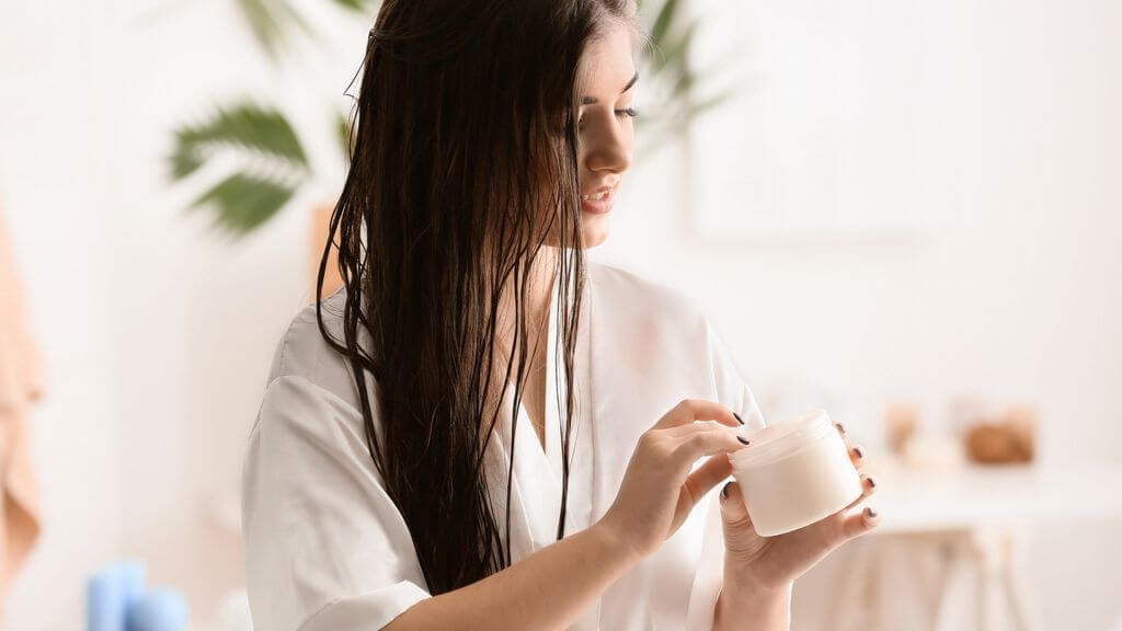 A woman about to apply hair masque