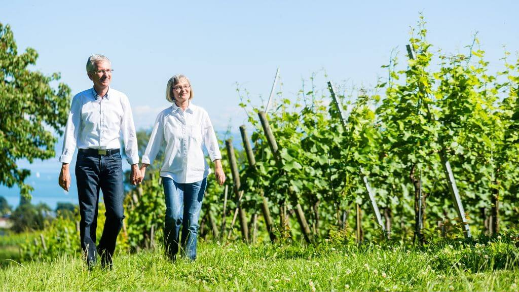 Elderly couple hiking in winery