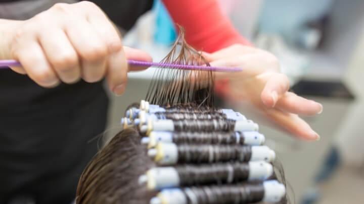 Woman having perm treatment at the hair salon
