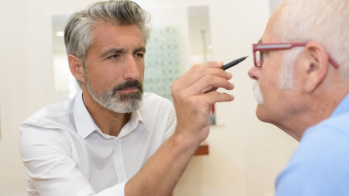 An ophthalmologist with his patient