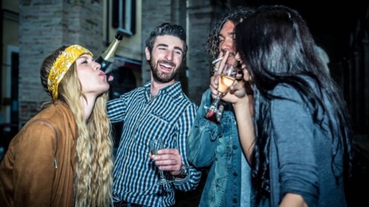 Teenagers partying with alcoholic drinks and cigarettes