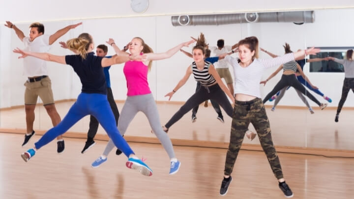 Teenagers exercising in a gym studio