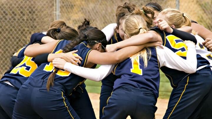 A girls sports team members in a huddle