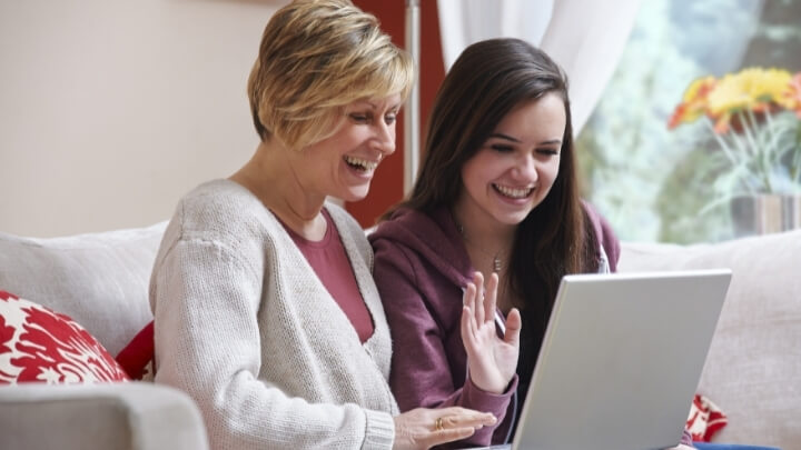 A teenager with her mom talking on a video call