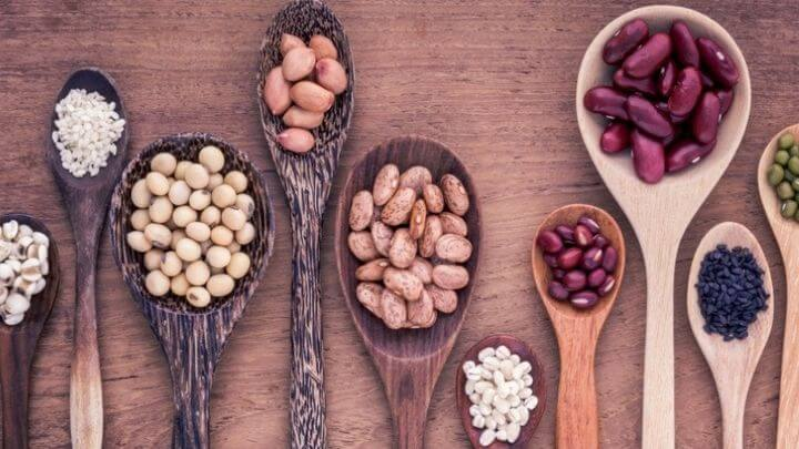 Wooden spoons with legumes