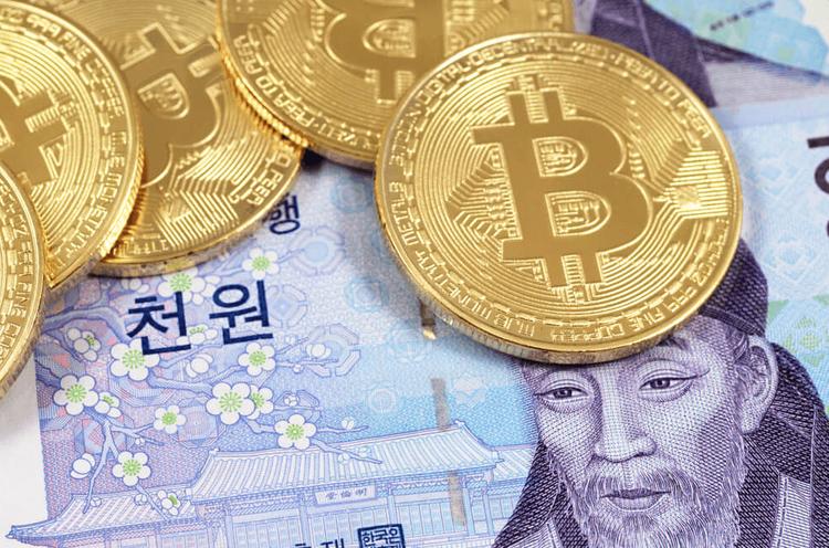 Bitcoins on top of Korean won bills