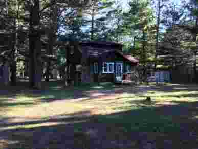Hunger & Ransom Cabin in the Woods, South Branch, MI · Exterior
