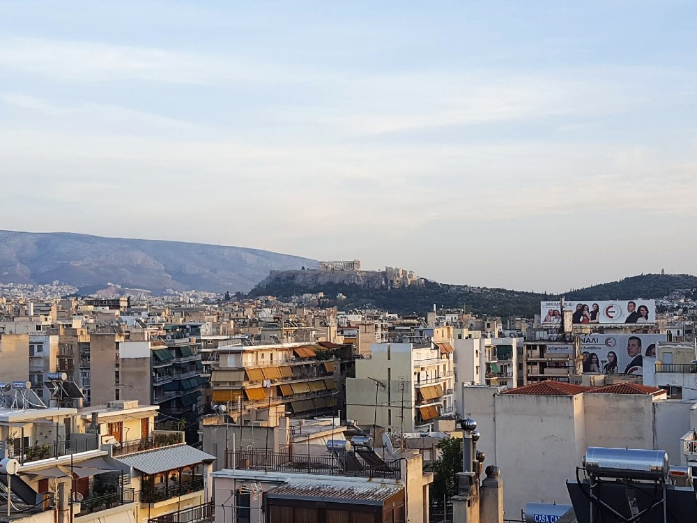 A view of the Acropolis in the distance, from the rooftop of our Airbnb.