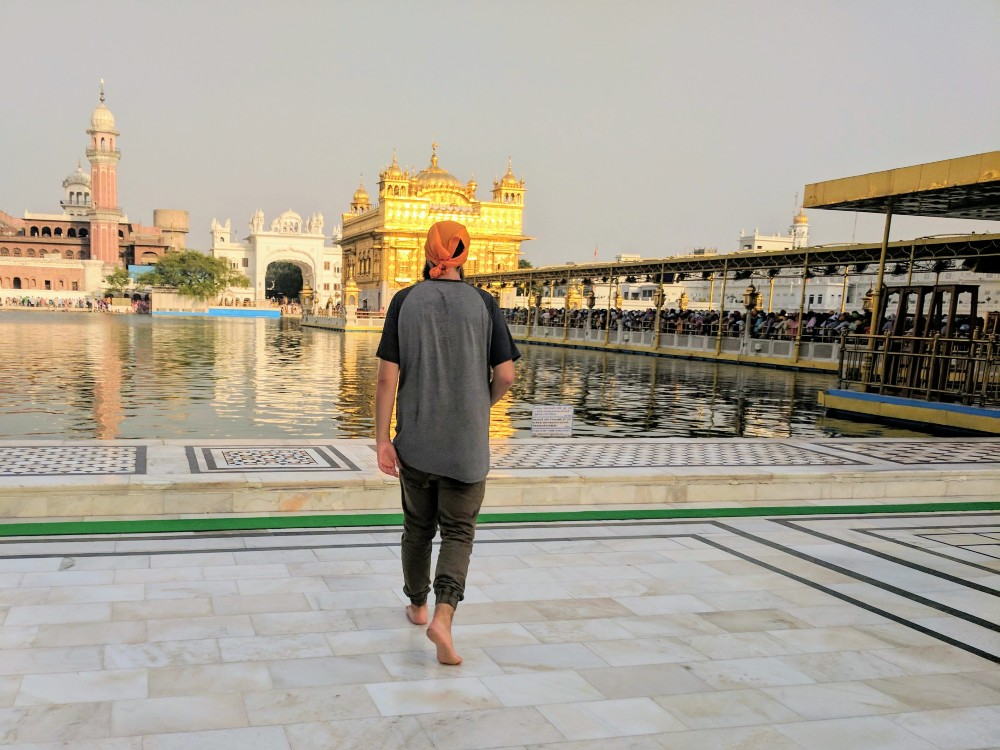 Visiting the Golden Temple of Amritsar in 45 degrees Celsius (113 Farenheit), drenched in sweat. Note that I'm walking quite gingerly on the marble because it's burning my feet.