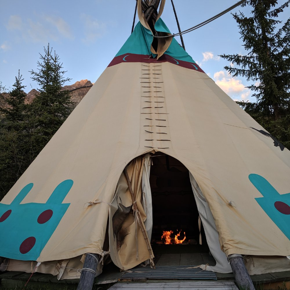 Our big little tipi, with a roaring fire.