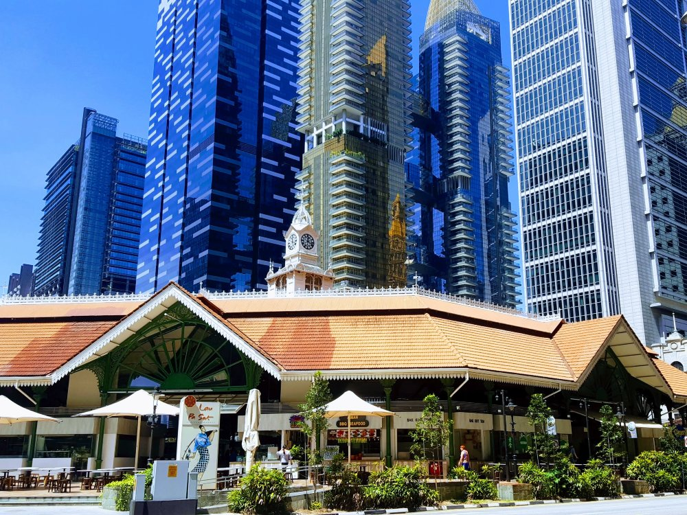 A Hawker Center surrounded by skyscrapers, a short walk from the metro station.