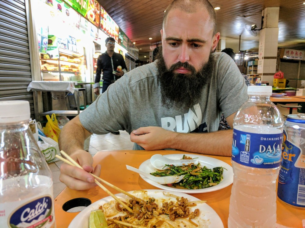 Enjoying our first ever meal in the Hawker Centre near our hostel in Little India. He's in disbelief at the great prices!